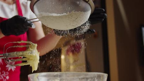 Slow Motion of Falling Sugar on Yeast Dough