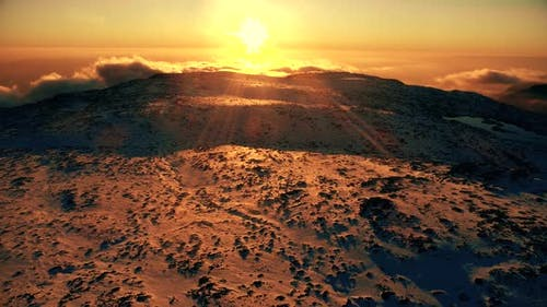 Mountain and Sun at Sunset in Winter. Aerial View