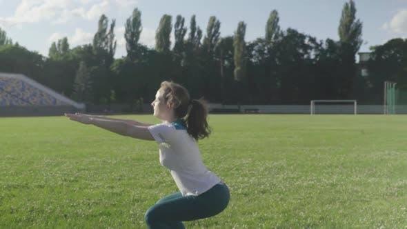 Girl Athlete Doing Gymnastics in the Stadium. Slow Motion