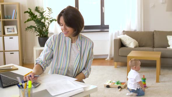 Thumbnail for Working Mother with Baby Boy at Home Office 26