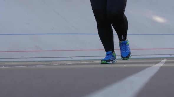 Thumbnail for Legs of Overweight Woman Running on Sports Stadium