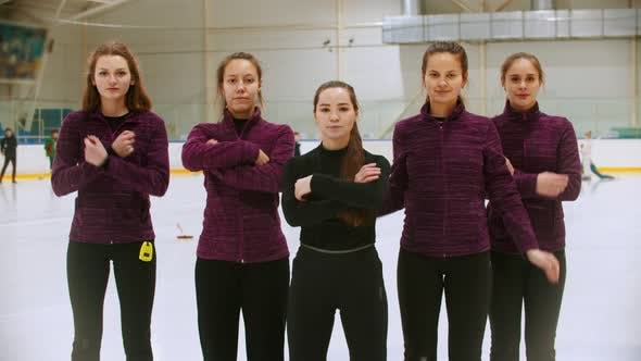 Thumbnail for Curling Training - the Judge Standing on the Ice Rink with Her Women Students - Crossing Their Hands