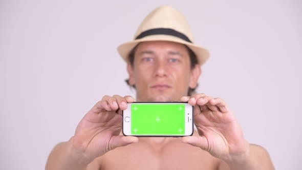 Thumbnail for Face of Happy Muscular Tourist Man Showing Phone Shirtless