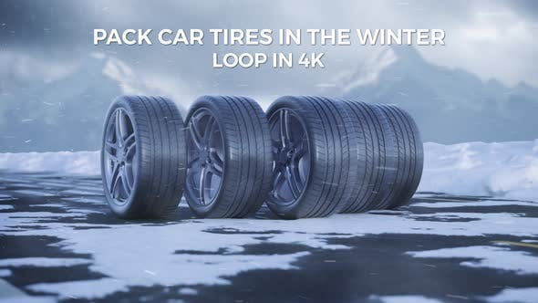 Car Tires Drive On A Snowy Road