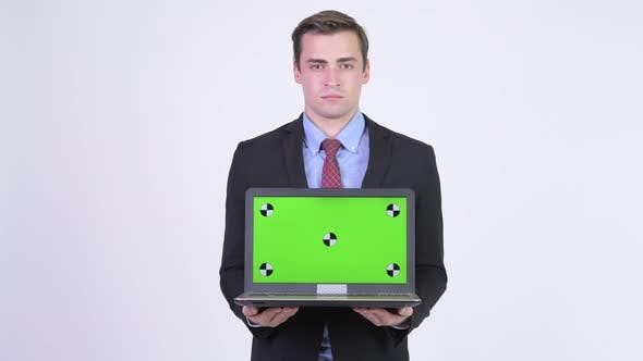 Thumbnail for Young Happy Handsome Businessman Showing Laptop