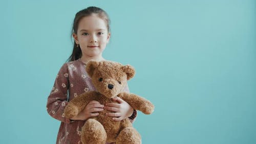 Adorable Little Girl with Plush Toy