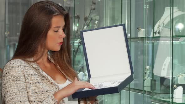 Thumbnail for Gorgeous Woman Smiling To the Camera, Holding Box with Jewelry Set
