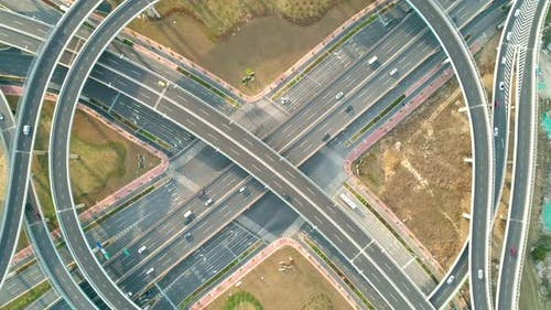 Top View To the Cars Driving on Multi-level Highway on the Sunset. Highway Multilevel Junction Road