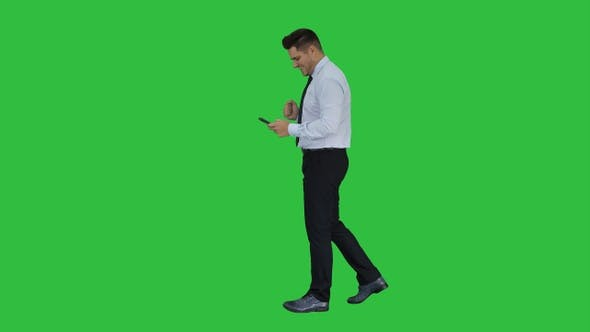 Thumbnail for Man walking looking on phone and making win gesture on