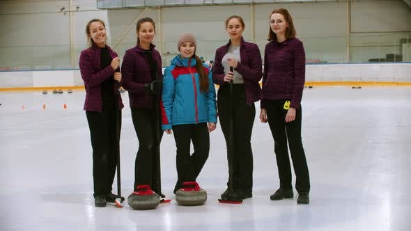 Cover Image for Curling Training - the Judge Standing on the Ice Rink with Her Students