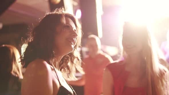 Thumbnail for Party with Dancing. Girls Fun Dancing in the Light of Colored Lamps