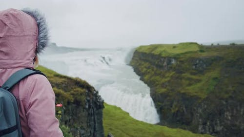 Tourist Woman Looking at Gullfoss Waterfall the Famous Attraction and Landmark Destination on