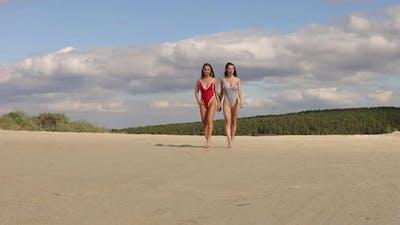 Sexy Women in Swimsuits Walking on Beach