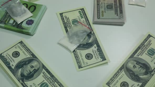 Thumbnail for Money And Cocaine On The Table