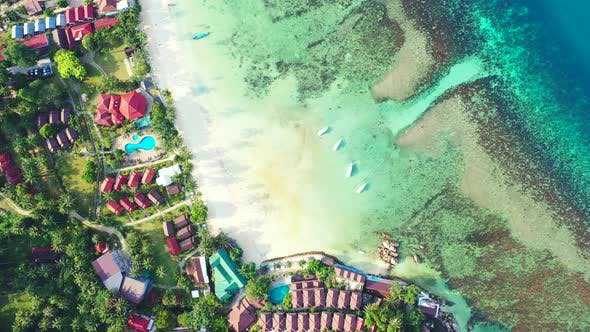 Luxury aerial abstract shot of a white sandy paradise beach and blue sea background in hi res