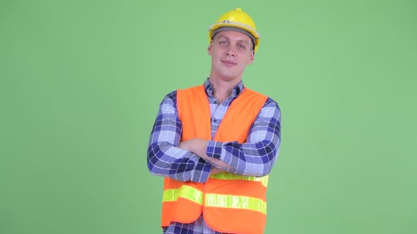 Thumbnail for Happy Young Man Construction Worker Smiling with Arms Crossed