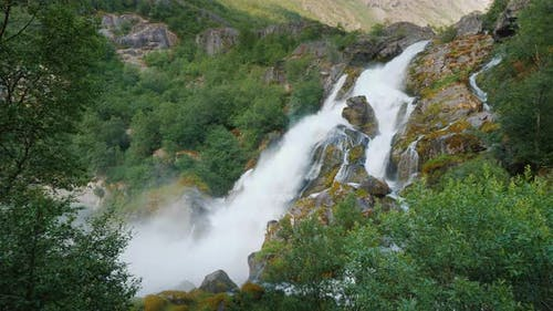 The Majestic Nature of Norway Is a Waterfall From the Meltwater of the Briksdal Glacier