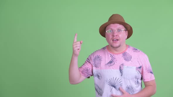 Thumbnail for Happy Overweight Bearded Tourist Man Pointing Up and Looking Excited