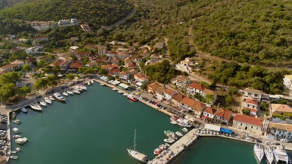 Thumbnail for Aerial view above of harbor on the coast of mediterranean sea, Greece.