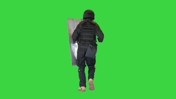 Riot Policeman Running with a Shield and Baton on a Green Screen Chroma Key