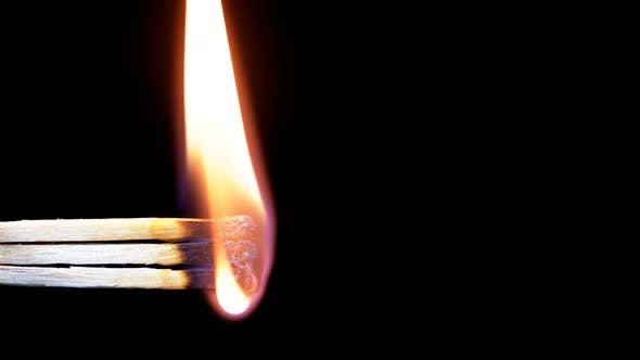 Thumbnail for Three Matches Are Lit a Flame on a Black Background
