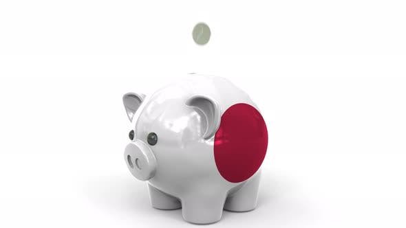 Thumbnail for Coins Fall Into Piggy Bank Painted with Flag of Japan