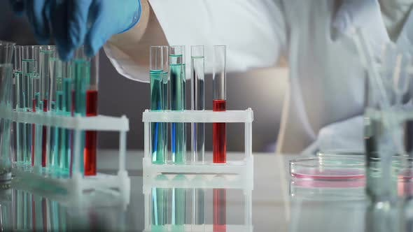 Thumbnail for Laboratory Worker Taking Away Already Tested Flask With Substance, Work Process