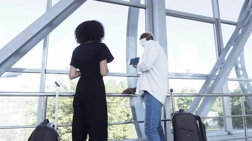 Couple of Newlywed Teenagers Standing in Airport Terminal at Station Wearing Medical Masks with