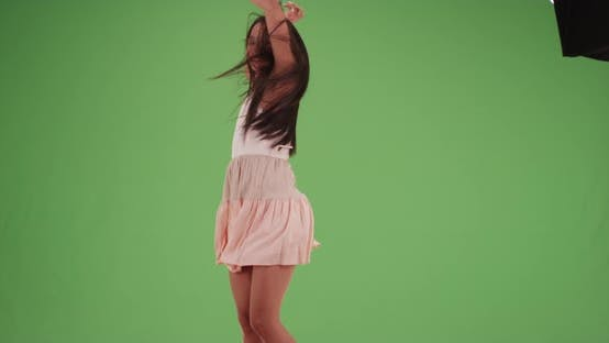 Thumbnail for Happy millennial Latina dancing around in a dress on green screen