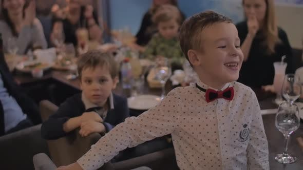 Child receiving congratulations on his birthday