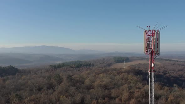 Thumbnail for Telecommunication tower and endless valley 4K drone video