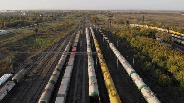 Aerial View. In the Frame, the Parking of Freight Trains. Long Trains with Tanks Are in the