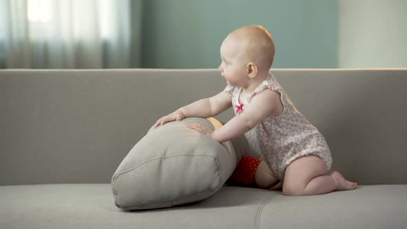 Thumbnail for Funny Happy Baby Girl Jumping on Sofa, Discovering World in Comfortable Diapers