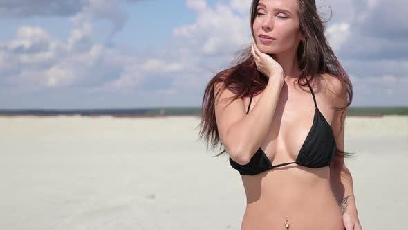 Thumbnail for Sensual Woman in Black Bikini Standing and Enjoying Sunshine