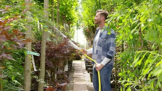 Thumbnail for Man Watering Plants in Garden