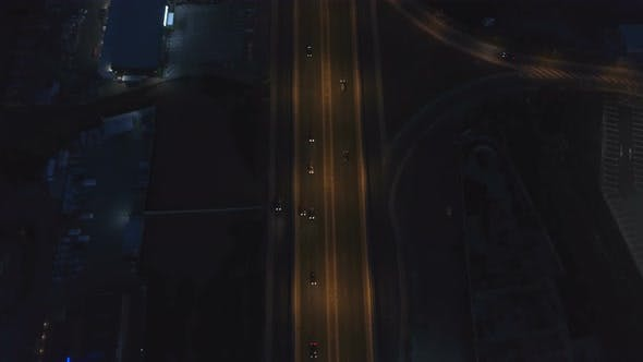Thumbnail for Road Intersection with Roundabout and City Traffic in the Night