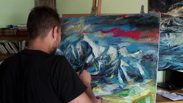 Male Artist Painting a Picture in a Studio