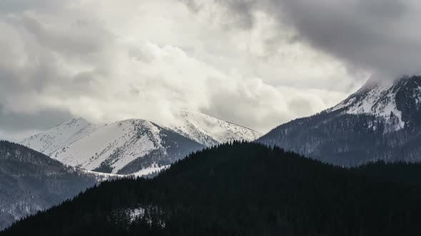 Thumbnail for Heavy Clouds in Snowy Mountains Time Lapse.
