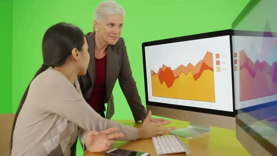 Thumbnail for Two businesswoman talk about the graphs on the computer screen on green screen