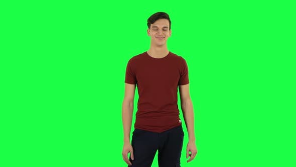 Cover Image for Guy Smiling While Looking at Camera. Green Screen