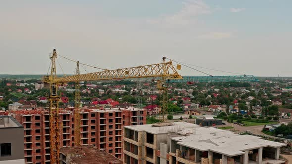 Thumbnail for Aerial Drone View. High Cranes Works on Building Site with a House. Flight From Bottom To Top