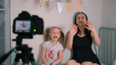 Little Girl and Mom Shooting Content for Internet