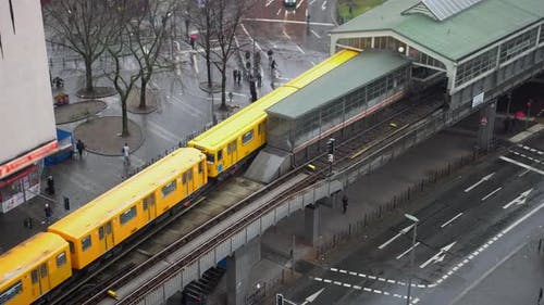Yellow Public Transport Train Exiting Subway Station Elevated Above Ground at Kottbusser Tor in
