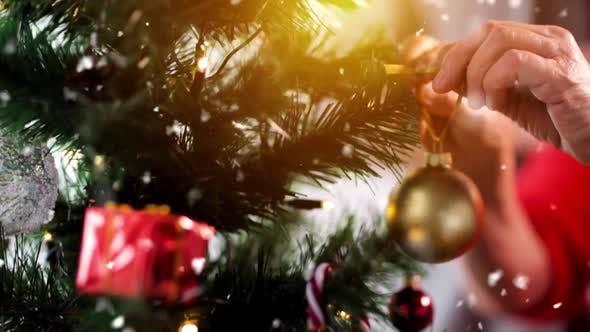 Thumbnail for Senior Woman Decorating Christmas Tree