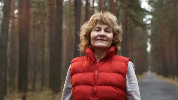 Thumbnail for Aged Woman on Walk in Forest