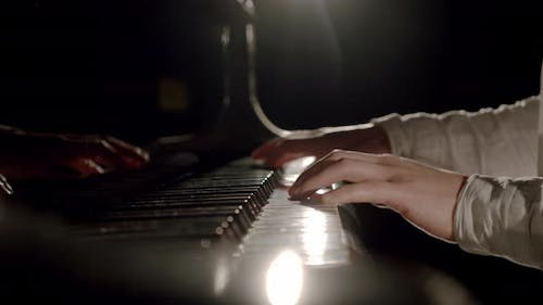Professional Pianist Hands Plays Gentle Classical Music on a Grand Piano. Slow Motion