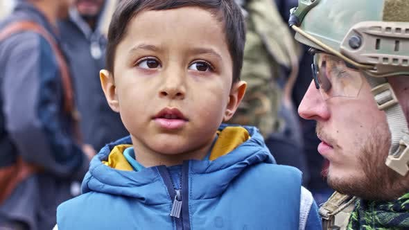 Thumbnail for Soldier Talking with Refugee Child