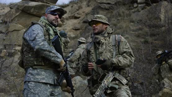 Thumbnail for Armed Soldiers Reviewing a Map