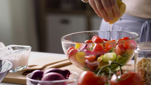 Thumbnail for Woman Cooking Vegetable Salad with Lemon at Home