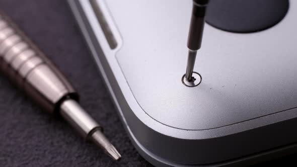 Master Unscrewing Small Screw with Magnetic Screwdriver Tool of Broken Laptop